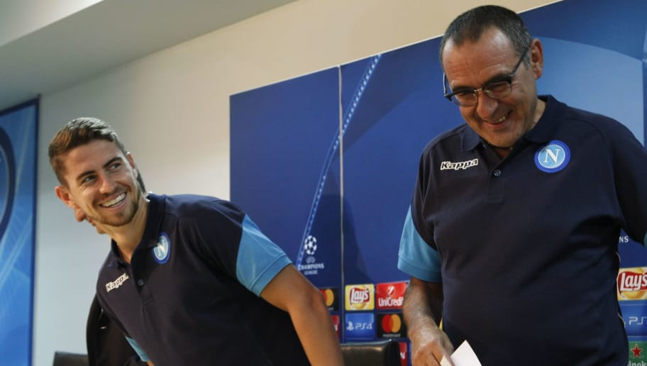 Napoli's midfielder from Brazil Jorginho (L) and Napoli's coach from Italy Maurizio Sarri attend a press conference on the eve of the Champion's League football match Napoli vs Feyenoord on September 25, 2017 in Naples.  / AFP PHOTO / Carlo Hermann        (Photo credit should read CARLO HERMANN/AFP/Getty Images)
