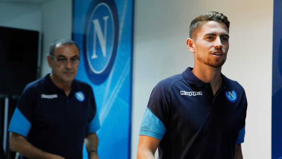 Napoli's midfielder from Brazil Jorginho (R) and Napoli's coach from Italy Maurizio Sarri attend a press conference on the eve of the Champion's League football match Napoli vs Feyenoord on September 25, 2017 in Naples.  / AFP PHOTO / Carlo Hermann        (Photo credit should read CARLO HERMANN/AFP/Getty Images)