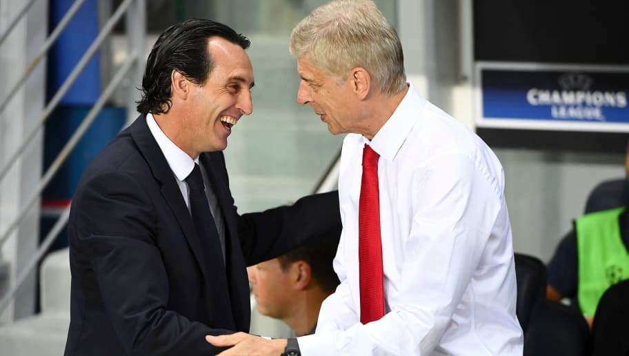 Paris Saint-Germain's Spanish head coach Unai Emery (L) shakes hands with Arsenal's French manager Arsene Wenger during the UEFA Champions League Group A football match between Paris-Saint-Germain and Arsenal FC on September 13, 2016 at the Parc des Princes stadium in Paris.  / AFP / FRANCK FIFE        (Photo credit should read FRANCK FIFE/AFP/Getty Images)