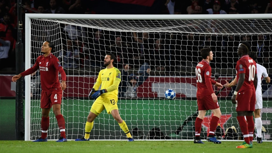 Liverpool's Brazilian goalkeeper Alisson (2nd L) reacts after Paris Saint-Germain's Spanish defender Juan Bernat (unseen0 scored a goal past him during the UEFA Champions League Group C football match between Paris Saint-Germain (PSG) and Liverpool FC at the Parc des Princes stadium, in Paris, on November 28, 2018. (Photo by Bertrand GUAY / AFP)        (Photo credit should read BERTRAND GUAY/AFP/Getty Images)