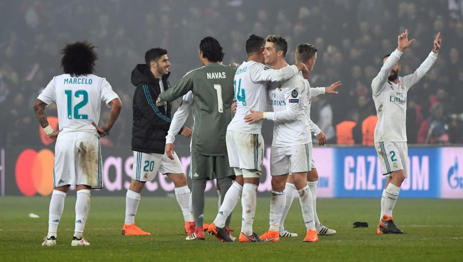 Real Madrid's players celebrate after winning the UEFA Champions League round of 16 second leg football match between Paris Saint-Germain (PSG) and Real Madrid on March 6, 2018, at the Parc des Princes stadium in Paris. / AFP PHOTO / PIERRE-PHILIPPE MARCOU        (Photo credit should read PIERRE-PHILIPPE MARCOU/AFP/Getty Images)