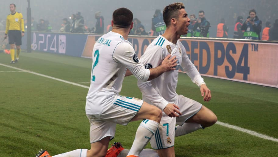 Real Madrid's Portuguese forward Cristiano Ronaldo (R) celebrates with Real Madrid's Spanish defender Dani Carvajal after scoring the opening goal  during the UEFA Champions League round of 16 second leg football match between Paris Saint-Germain (PSG) and Real Madrid on March 6, 2018, at the Parc des Princes stadium in Paris. / AFP PHOTO / GEOFFROY VAN DER HASSELT        (Photo credit should read GEOFFROY VAN DER HASSELT/AFP/Getty Images)