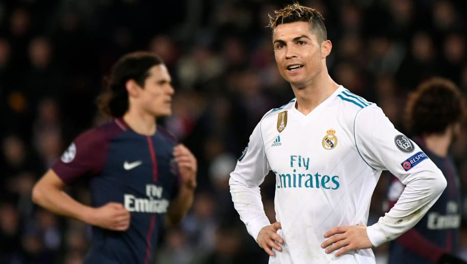Real Madrid's Portuguese forward Cristiano Ronaldo (R) reacts  during the UEFA Champions League round of 16 second leg football match between Paris Saint-Germain (PSG) and Real Madrid on March 6, 2018, at the Parc des Princes stadium in Paris. / AFP PHOTO / PIERRE-PHILIPPE MARCOU        (Photo credit should read PIERRE-PHILIPPE MARCOU/AFP/Getty Images)