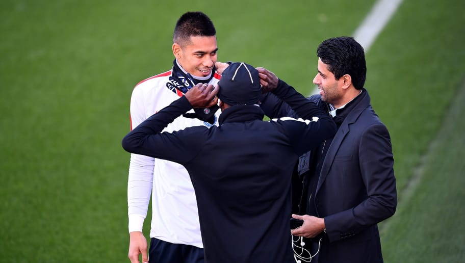 Paris Saint-Germain's Qatari president Nasser Al-Khelaïfi (R) speaks with Paris Saint-Germain's French goalkeeper Alphonse Areola (L) during a training session on December 5, 2016 in Saint-Germain-en-Laye, western Paris, on the eve of the team's UEFA Champions League football match against PFC Ludogorets Razgrad.  / AFP / FRANCK FIFE        (Photo credit should read FRANCK FIFE/AFP/Getty Images)