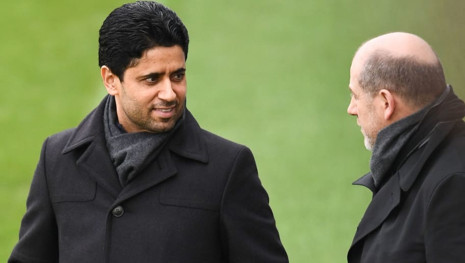 Paris Saint-Germain's Qatari president Nasser Al-Khelaïfi (L) and Paris Saint-Germain's Portuguese sporting director Antero Henrique talk during a training session on March 5, 2018 at the Ooredoo training center in Saint-Germain-en-Laye, west of Paris, on the eve of their Champions' League football match against Real Madrid CF.  / AFP PHOTO / FRANCK FIFE        (Photo credit should read FRANCK FIFE/AFP/Getty Images)