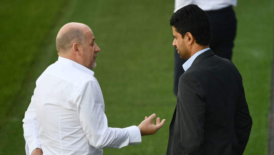 Paris Saint-Germain's Portuguese sporting director Antero Henrique (L) speaks with Qatari president Nasser Al-Khelaifi (R) during a training session at the Camp des Loges training camp on September 17, 2018 in Saint-Germain-en-Laye, near Paris, on the eve of an UEFA Champions League football match against Liverpool. (Photo by FRANCK FIFE / AFP)        (Photo credit should read FRANCK FIFE/AFP/Getty Images)