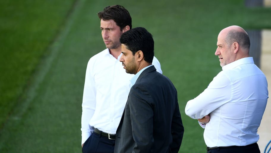 Paris Saint-Germain's Qatari president Nasser Al-Khelaifi (C), Brazilian sport coordinator Maxwell (L) and Portuguese sporting director Antero Henrique (R) attend a training session at the Camp des Loges training camp on September 17, 2018 in Saint-Germain-en-Laye, near Paris, on the eve of an UEFA Champions League football match against Liverpool. (Photo by FRANCK FIFE / AFP)        (Photo credit should read FRANCK FIFE/AFP/Getty Images)