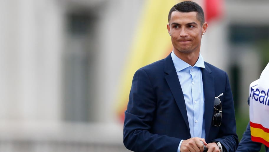 Real Madrid's Portuguese forward Cristiano Ronaldo gestures at Cibeles square in Madrid on May 27, 2018 after Real Madrid won their third Champions League title in a row in Kiev. (Photo by BENJAMIN CREMEL / AFP)        (Photo credit should read BENJAMIN CREMEL/AFP/Getty Images)