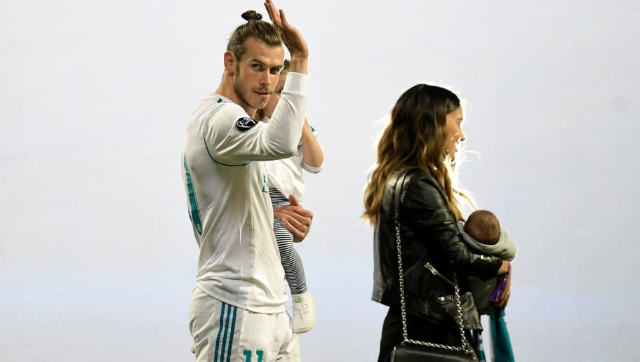 Real Madrid's Welsh forward Gareth Bale waves at the Santiago Bernabeu stadium in Madrid on May 27, 2018 during a victory ceremony after Real Madrid won its third Champions League title in a row in Kiev. (Photo by OSCAR DEL POZO / AFP)        (Photo credit should read OSCAR DEL POZO/AFP/Getty Images)