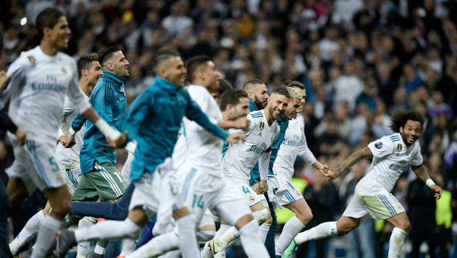 Real Madrid's players celebrate at the end of the UEFA Champions League semi-final second leg football match between Real Madrid and Bayern Munich at the Santiago Bernabeu Stadium in Madrid on May 1, 2018. (Photo by OSCAR DEL POZO / AFP)        (Photo credit should read OSCAR DEL POZO/AFP/Getty Images)