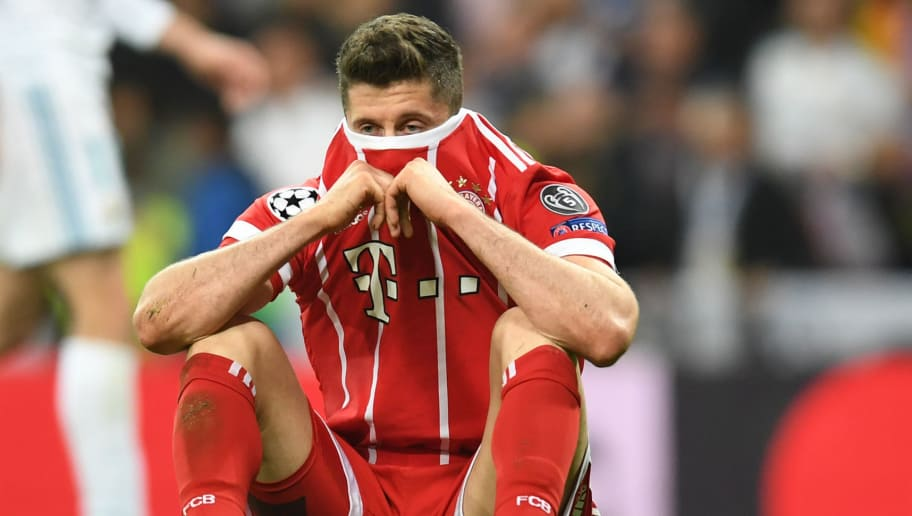 Bayern Munich's Polish forward Robert Lewandowski reacts after the UEFA Champions League semi-final second-leg football match Real Madrid CF vs FC Bayern Munich in Madrid, Spain, on May 1, 2018. (Photo by Christof STACHE / AFP)        (Photo credit should read CHRISTOF STACHE/AFP/Getty Images)