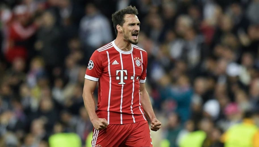 Bayern Munich's German defender Mats Hummels celebrates his team's second goal during the UEFA Champions League semi-final second leg football match between Real Madrid and Bayern Munich at the Santiago Bernabeu Stadium in Madrid on May 1, 2018. (Photo by OSCAR DEL POZO / AFP)        (Photo credit should read OSCAR DEL POZO/AFP/Getty Images)