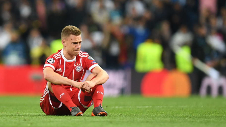 Bayern Munich's German midfielder Joshua Kimmich reacts after the UEFA Champions League semi-final second-leg football match Real Madrid CF vs FC Bayern Munich in Madrid, Spain, on May 1, 2018. (Photo by Christof STACHE / AFP)        (Photo credit should read CHRISTOF STACHE/AFP/Getty Images)