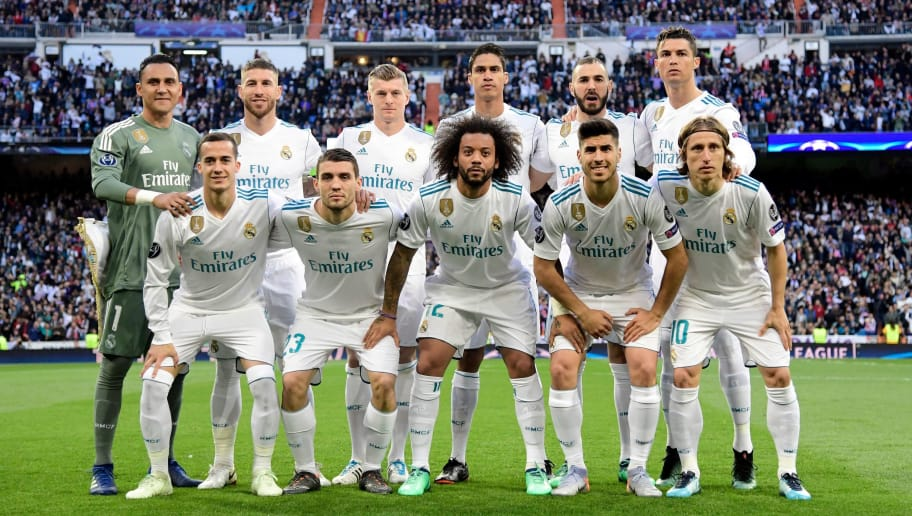 (TOP L-R) Real Madrid's Costa Rican goalkeeper Keylor Navas, Real Madrid's Spanish defender Sergio Ramos, Real Madrid's German midfielder Toni Kroos, Real Madrid's French defender Raphael Varane, Real Madrid's French forward Karim Benzema, Real Madrid's Portuguese forward Cristiano Ronaldo, (BOTTOM L-R) Real Madrid's Spanish midfielder Lucas Vazquez, Real Madrid's Croatian midfielder Mateo Kovacic, Real Madrid's Brazilian defender Marcelo, Real Madrid's Spanish midfielder Marco Asensio and Real Madrid's Croatian midfielder Luka Modric pose before the UEFA Champions League semi-final second leg football match between Real Madrid and Bayern Munich at the Santiago Bernabeu Stadium in Madrid on May 1, 2018. (Photo by JAVIER SORIANO / AFP)        (Photo credit should read JAVIER SORIANO/AFP/Getty Images)