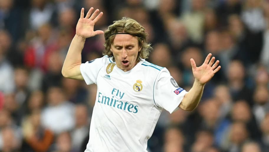 Real Madrid's Croatian midfielder Luka Modric (L) reacts next to Bayern Munich's German forward Thomas Mueller during the UEFA Champions League semi-final second-leg football match Real Madrid CF vs FC Bayern Munich in Madrid, Spain, on May 1, 2018. (Photo by Christof STACHE / AFP)        (Photo credit should read CHRISTOF STACHE/AFP/Getty Images)