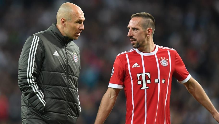 Bayern Munich's Dutch midfielder Arjen Robben (L) and Bayern Munich's French midfielder Franck Ribery react after the UEFA Champions League semi-final second-leg football match Real Madrid CF vs FC Bayern Munich in Madrid, Spain, on May 1, 2018. (Photo by Christof STACHE / AFP)        (Photo credit should read CHRISTOF STACHE/AFP/Getty Images)