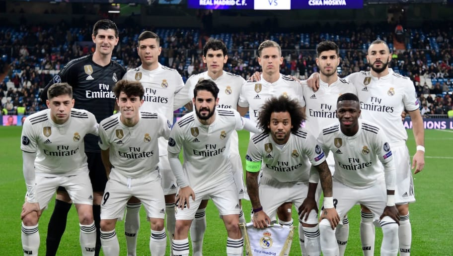 (BACK L-R) Real Madrid's Belgian goalkeeper Thibaut Courtois, Real Madrid's Spanish defender Javier Sanchez, Real Madrid's Spanish defender Jesus Vallejo, Real Madrid's Spanish miedfieder Marcos Llorente, Real Madrid's Spanish midfielder Marco Asensio, Real Madrid's French forward Karim Benzema, (FRONT L-R) Real Madrid's Uruguayan midfielder Federico Valverde, Real Madrid's Spanish defender Alvaro Odriozola, Real Madrid's Spanish midfielder Isco, Real Madrid's Brazilian defender Marcelo and Real Madrid's Brazilian forward Vinicius Junior pose before the UEFA Champions League group G football match between Real Madrid CF and CSKA Moscow at the Santiago Bernabeu stadium in Madrid on December 12, 2018. (Photo by JAVIER SORIANO / AFP)        (Photo credit should read JAVIER SORIANO/AFP/Getty Images)