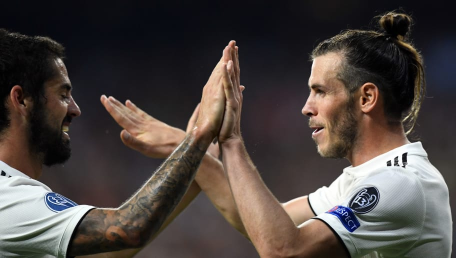Real Madrid's Welsh forward Gareth Bale (R) celebrates scoring his team's second goal with Real Madrid's Spanish midfielder Isco during the UEFA Champions League group G football match between Real Madrid CF and AS Roma at the Santiago Bernabeu stadium in Madrid on September 19, 2018. (Photo by GABRIEL BOUYS / AFP)        (Photo credit should read GABRIEL BOUYS/AFP/Getty Images)