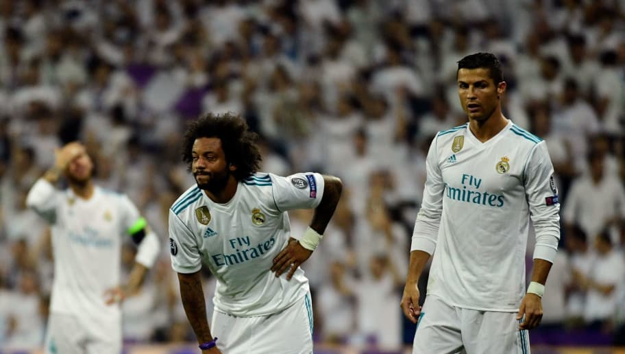 Real Madrid's defender from Brazil Marcelo (C) gestures past Real Madrid's forward from Portugal Cristiano Ronaldo during the UEFA Champions League football match Real Madrid CF vs APOEL FC at the Santiago Bernabeu stadium in Madrid on September 13, 2017. / AFP PHOTO / PIERRE-PHILIPPE MARCOU        (Photo credit should read PIERRE-PHILIPPE MARCOU/AFP/Getty Images)