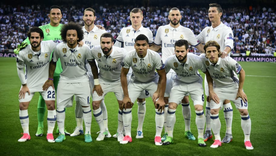 Real Madrid squad (back row L to R) Real Madrid's Costa Rican goalkeeper Keylor Navas, Real Madrid's defender Sergio Ramos, Real Madrid's German midfielder Toni Kroos, Real Madrid's French forward Karim Benzema, Real Madrid's Portuguese forward Cristiano Ronaldo, (front row L to R) Real Madrid's midfielder Isco, Real Madrid's Brazilian defender Marcelo, Real Madrid's defender Dani Carvajal, Real Madrid's Brazilian midfielder Casemiro, Real Madrid's defender Nacho Fernandez and Real Madrid's Croatian midfielder Luka Modric pose before the UEFA Champions League quarter-final second leg football match Real Madrid vs FC Bayern Munich at the Santiago Bernabeu stadium in Madrid in Madrid on April 18, 2017. / AFP PHOTO / JAVIER SORIANO        (Photo credit should read JAVIER SORIANO/AFP/Getty Images)