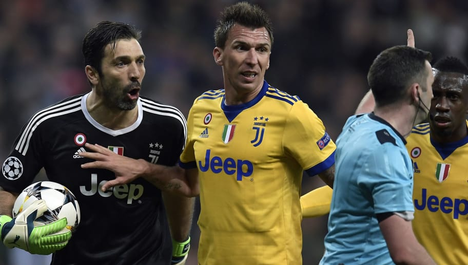 Juventus' Italian goalkeeper Gianluigi Buffon (L) argues with the referee during the UEFA Champions League quarter-final second leg football match between Real Madrid CF and Juventus FC at the Santiago Bernabeu stadium in Madrid on April 11, 2018. / AFP PHOTO / OSCAR DEL POZO        (Photo credit should read OSCAR DEL POZO/AFP/Getty Images)