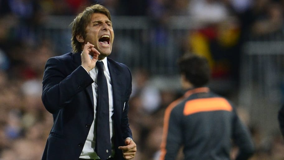 Juventus' coach Antonio Conte reacts during the UEFA Champions League Group B football match Real Madrid CF vs Juventus at the Santiago Bernabeu stadium in Madrid on October 23, 2013.   AFP PHOTO/ JAVIER SORIANO        (Photo credit should read JAVIER SORIANO/AFP/Getty Images)