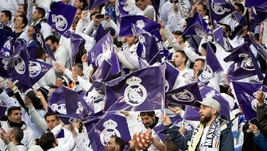 Real Madrid fans wave flags before the UEFA Champions League quarter-final  second leg football ee1be786bea3d