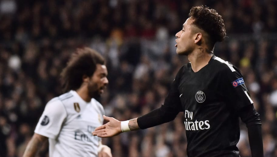 Paris Saint-Germain's Brazilian forward Neymar gestures during the UEFA Champions League round of sixteen first leg football match Real Madrid CF against Paris Saint-Germain (PSG) at the Santiago Bernabeu stadium in Madrid on February 14, 2018.   / AFP PHOTO / CHRISTOPHE SIMON        (Photo credit should read CHRISTOPHE SIMON/AFP/Getty Images)