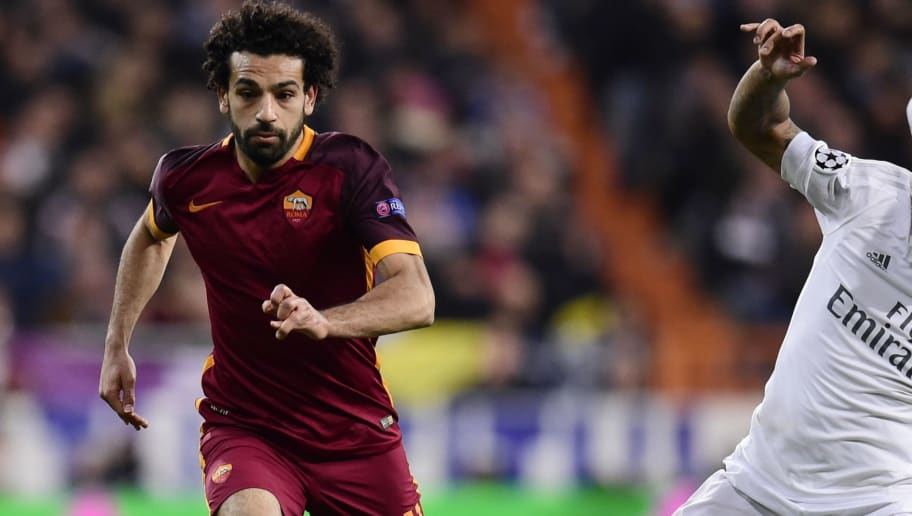 Roma's midfielder from Egypt Mohamed Salah (L) vies with Real Madrid's Brazilian defender Marcelo during the UEFA Champions League round of 16, second leg football match Real Madrid FC vs AS Roma at the Santiago Bernabeu stadium in Madrid on March 8, 2016. / AFP / JAVIER SORIANO        (Photo credit should read JAVIER SORIANO/AFP/Getty Images)