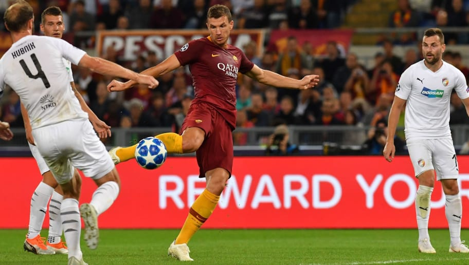 AS Rome's Bosnian forward Edin Dzeko (C) shoots to score his second goal during the UEFA Champions League group G football match between AS Roma and FC Viktoria Plzen on October 2, 2018 at the Olympic stadium in Rome. (Photo by Andreas SOLARO / AFP)        (Photo credit should read ANDREAS SOLARO/AFP/Getty Images)