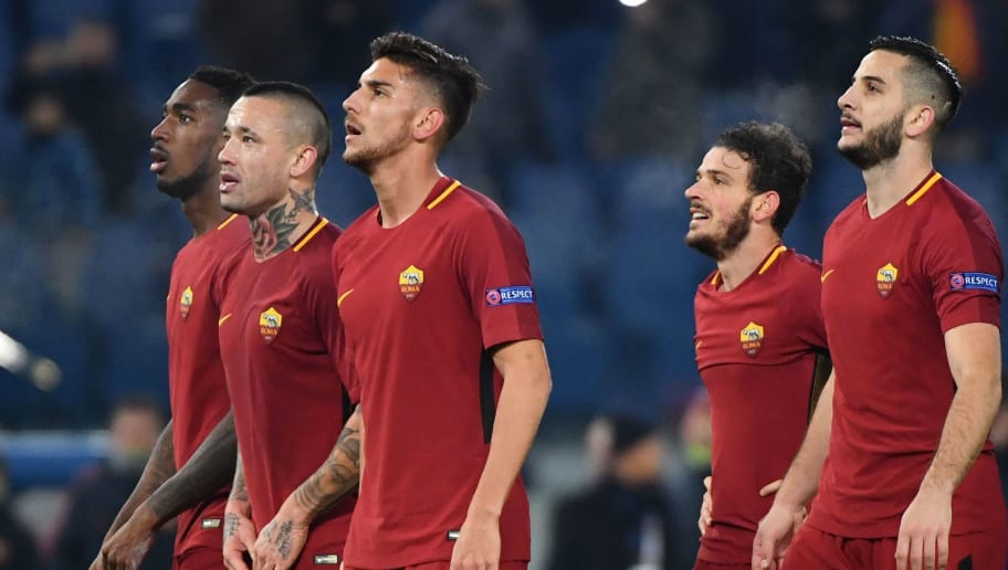 From left : Roma's Brazilian midfielder Gerson, Roma's Belgian midfielder Radja Nainggolan, Roma's Italian midfielder Lorenzo Pellegrini, Roma's Italian midfielder Alessandro Florenzi, Roma's Greek defender Kostas Manolas and Roma's Croatian defender Aleksandar Kolarov celebrate at the end of the UEFA Champions League Group C football match AS Roma vs FK Qarabag on December 5, 2017 at the Olympic stadium in Rome. Roma won 1-0 and reach Champions League last 16. / AFP PHOTO / Alberto PIZZOLI        (Photo credit should read ALBERTO PIZZOLI/AFP/Getty Images)