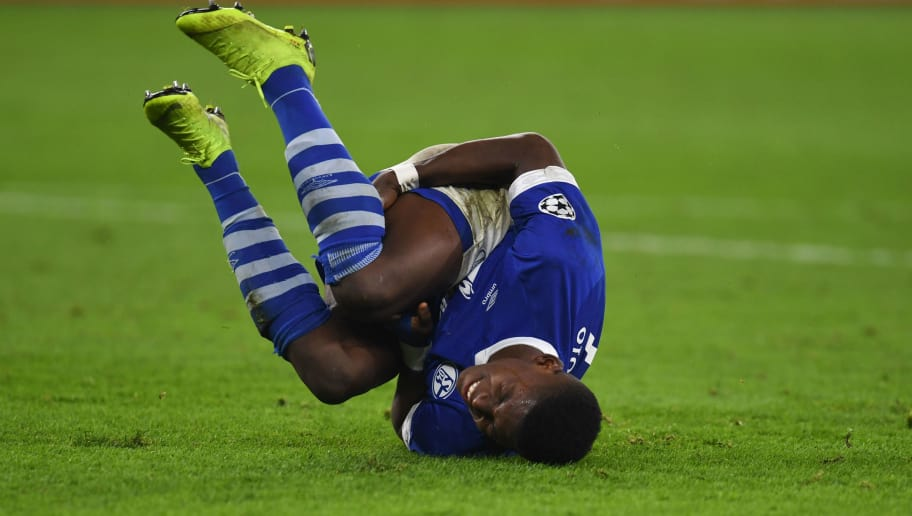 Schalke's Swiss forward Breel Embolo goes down during the UEFA Champions League group D football match FC Schalke 04 v Galatasaray in Gelsenkirchen, western Germany, on November 6, 2018. (Photo by Patrik STOLLARZ / AFP)        (Photo credit should read PATRIK STOLLARZ/AFP/Getty Images)