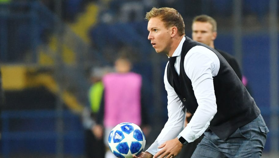 Hoffenheim's coach Julian Nagelsmann holds a ball  during the UEFA Champions League Group F football match between FC Shakhtar Donetsk and TSG 1899 Hoffenheim at the Metalist Stadium in Kharkiv on September 19, 2018. (Photo by SERGEI SUPINSKY / AFP)        (Photo credit should read SERGEI SUPINSKY/AFP/Getty Images)