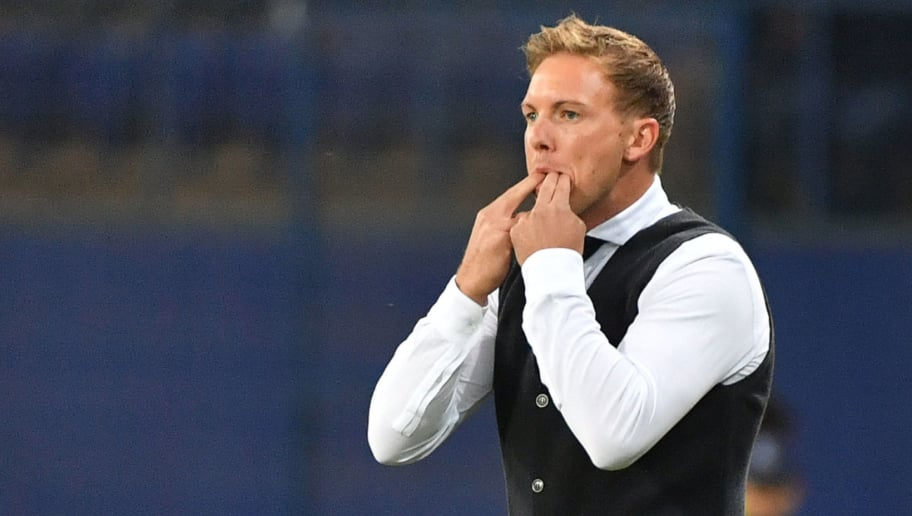 Hoffenheim's coach Julian Nagelsmann reacts during the UEFA Champions League Group F football match between FC Shakhtar Donetsk and TSG 1899 Hoffenheim at the Metalist Stadium in Kharkiv on September 19, 2018. (Photo by SERGEI SUPINSKY / AFP)        (Photo credit should read SERGEI SUPINSKY/AFP/Getty Images)