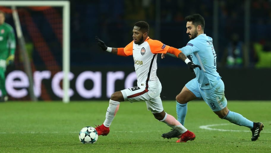 Shakhtar Donetsk's Brazilian midfielder Fred drives the ball ahead of Manchester City's German midfielder Ilkay Gundogan (R) during the UEFA Champions League group F football match between Shakhtar Donetsk and Manchester City, on December 6, 2017, at the Metalist stadium in Kharkiv, Eastern Ukraine. / AFP PHOTO / Stanislas VEDMID        (Photo credit should read STANISLAS VEDMID/AFP/Getty Images)