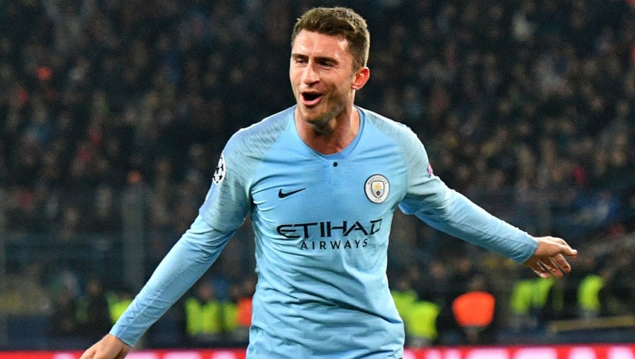 Manchester City's French defender Aymeric Laporte celebrates after scoring a goal during the UEFA Champions League football match between Shakhtar Donetsk and Manchester City at the Metallist stadium in Kharkiv, on October 23, 2018. (Photo by GENYA SAVILOV / AFP)        (Photo credit should read GENYA SAVILOV/AFP/Getty Images)