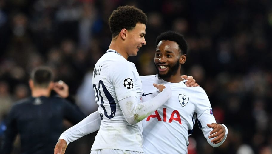 Tottenham Hotspur's French midfielder Georges-Kevin N'Koudou (R) vies with Tottenham Hotspur's English midfielder Dele Alli (L) after scoring their third goal during the UEFA Champions League Group H football match between Tottenham Hotspur and Apoel Nicosia at Wembley Stadium in London, on December 6, 2017. / AFP PHOTO / Ben STANSALL        (Photo credit should read BEN STANSALL/AFP/Getty Images)