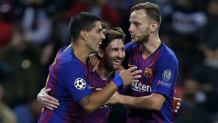 Barcelona's Argentinian striker Lionel Messi (C) celebrates with teammates after scoring their third goal during the Champions League group B football match match between Tottenham Hotspur and Barcelona at Wembley Stadium in London, on October 3, 2018. (Photo by Ian KINGTON / IKIMAGES / AFP)        (Photo credit should read IAN KINGTON/AFP/Getty Images)