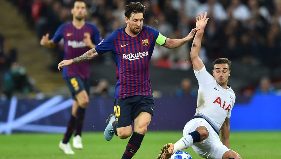Barcelona's Argentinian striker Lionel Messi is tackled by Tottenham Hotspur's English midfielder Harry Winks (R) during the Champions League group B football match match between Tottenham Hotspur and Barcelona at Wembley Stadium in London, on October 3, 2018. (Photo by Glyn KIRK / AFP)        (Photo credit should read GLYN KIRK/AFP/Getty Images)