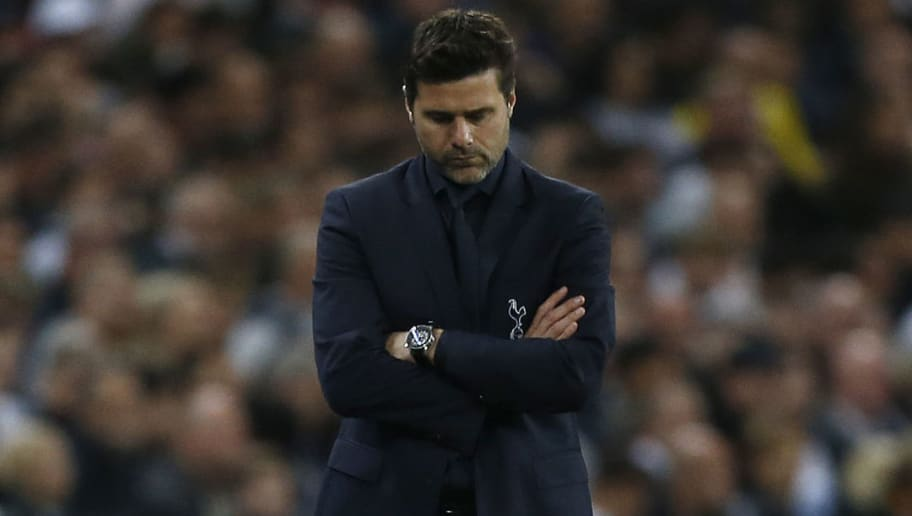 Tottenham Hotspur's Argentinian head coach Mauricio Pochettino reacts during the Champions League group B football match match between Tottenham Hotspur and Barcelona at Wembley Stadium in London, on October 3, 2018. (Photo by Ian KINGTON / IKIMAGES / AFP)        (Photo credit should read IAN KINGTON/AFP/Getty Images)