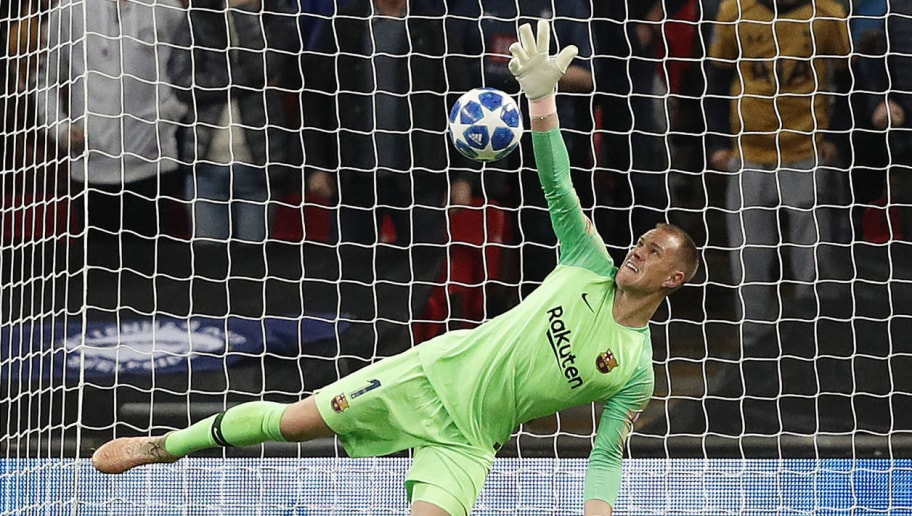 Barcelona's German goalkeeper Marc-Andre Ter Stegen makes a save during the Champions League group B football match match between Tottenham Hotspur and Barcelona at Wembley Stadium in London, on October 3, 2018. (Photo by Adrian DENNIS / AFP)        (Photo credit should read ADRIAN DENNIS/AFP/Getty Images)