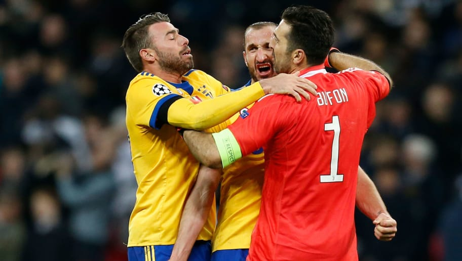 Juventus players Juventus' Italian goalkeeper Gianluigi Buffon (R), Juventus' Italian defender Giorgio Chiellini (C) and Juventus' Italian defender Andrea Barzagli (L) celebrate their victory at the final whistle during the UEFA Champions League round of sixteen second leg football match between Tottenham Hotspur and Juventus at Wembley Stadium in London, on March 7, 2018. / AFP PHOTO / Ian KINGTON        (Photo credit should read IAN KINGTON/AFP/Getty Images)