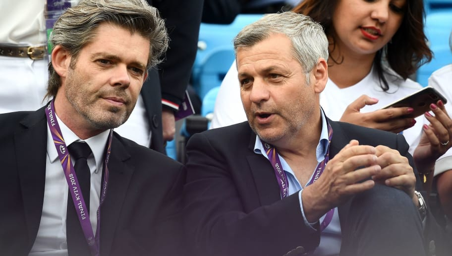 Lyon's French head coach Bruno Genesio (R) chats with an unidentified person during the UEFA Women's Champions League final football match Vfl Wolfsburg vs Olympique Lyonnais at the Valeriy Lobanovsky stadium in Kiev on May 24, 2018. (Photo by FRANCK FIFE / AFP)        (Photo credit should read FRANCK FIFE/AFP/Getty Images)