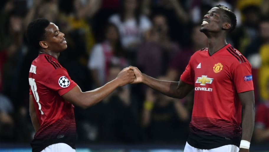 Manchester United's French midfielder Paul Pogba (R) and Manchester United's French striker Anthony Martial react after the UEFA Champions League group H football match between Young Boys and Manchester United at The Stade de Suisse in Bern on September 19, 2018. (Photo by Fabrice COFFRINI / AFP)        (Photo credit should read FABRICE COFFRINI/AFP/Getty Images)