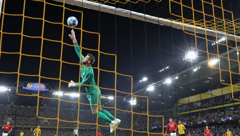 Manchester United's Spanish goalkeeper David de Gea (C) deflects the ball during  the UEFA Champions League group H football match between Young Boys and Manchester United at The Stade de Suisse in Bern on September 19, 2018. (Photo by Fabrice COFFRINI / AFP)        (Photo credit should read FABRICE COFFRINI/AFP/Getty Images)