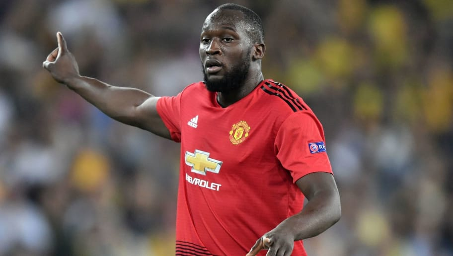 Manchester United's Belgian striker Romelu Lukaku gestures during the UEFA Champions League group H football match between Young Boys and Manchester United at The Stade de Suisse in Bern on September 19, 2018. (Photo by Fabrice COFFRINI / AFP)        (Photo credit should read FABRICE COFFRINI/AFP/Getty Images)