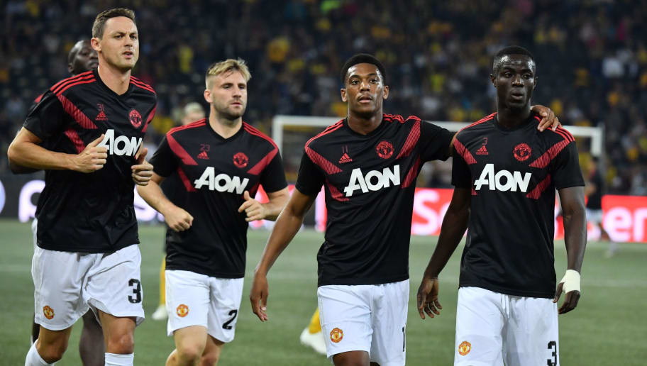 (L/R): Manchester United's Serbian midfielder Nemanja Matic, Swedish defender Victor Lindelof, French striker Anthony Martial and Manchester United's Ivorian defender Eric Bailly warm up ahead of the UEFA Champions League group H football match between Young Boys and Manchester United at The Stade de Suisse in Bern on September 19, 2018. (Photo by Alain GROSCLAUDE / AFP)        (Photo credit should read ALAIN GROSCLAUDE/AFP/Getty Images)