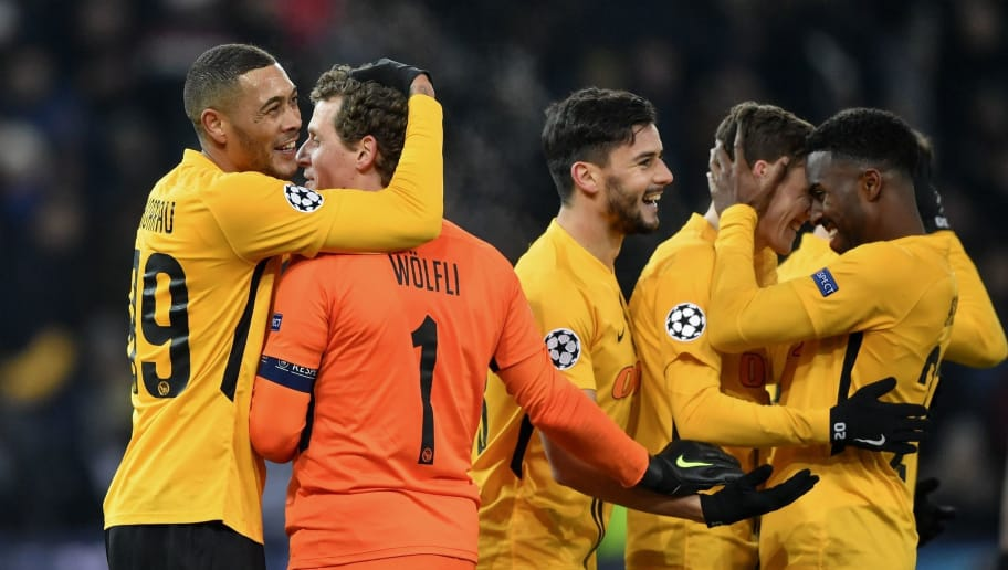 Young Boys' French forward Guillaume Hoarau (Far L) who scores the two team's goal reacts with Young Boys' Swiss goalkeeper Marco Woelfli at the end of the UEFA Champions League group H football match between Young Boys and Juventus at the Stade de Suisse stadium on December 12, 2018 in Bern. (Photo by Fabrice COFFRINI / AFP)        (Photo credit should read FABRICE COFFRINI/AFP/Getty Images)