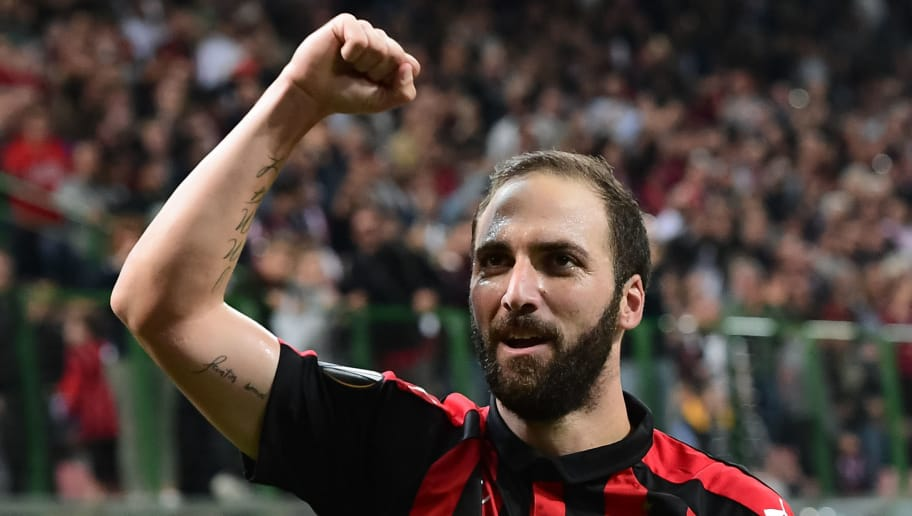 AC Milan's Argentine forward Gonzalo Higuain celebrates after scoring during the Europa League Group F football match between AC Milan and Olympiakos at the San Siro stadium on October 4, 2018 in Milan. (Photo by Miguel MEDINA / AFP)        (Photo credit should read MIGUEL MEDINA/AFP/Getty Images)