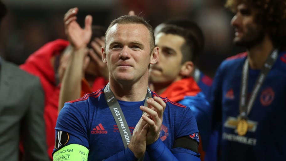 Manchester United's English striker Wayne Rooney celebrates after the UEFA Europa League final football match Ajax Amsterdam v Manchester United on May 24, 2017 at the Friends Arena in Solna outside Stockholm. / AFP PHOTO / Soren Andersson        (Photo credit should read SOREN ANDERSSON/AFP/Getty Images)